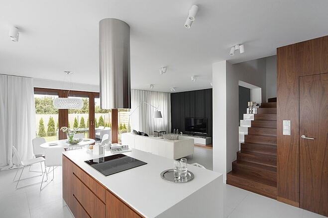 Love the clean lines and white, modern style warmed up with some beautiful woods.